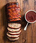 Bacon wrapped meat loaf with smoky barbecue sauce