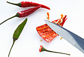 A chilli being deseeded