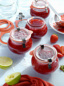 Strawberry jam in preserving jars