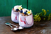 Chia pudding with granola, blueberries and strawberries