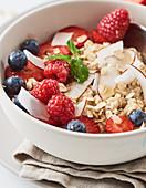 Porridge with fresh berries and coconut flakes