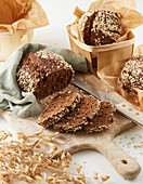 Homemade brown bread with oat flakes