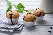 Vegan muffins with sweet cherry jam and chocolate chips