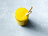 An orange and mango smoothie with turmeric