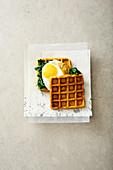 Sweet potato waffles with spinach and egg