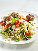 Barley with vegetables and meatballs
