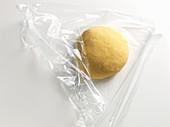 Pasta dough in cling film