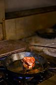 Filet Steak cooking in pan