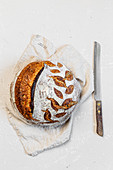 Round sourdough loaf on white background