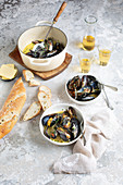 Pot of mussels with white wine and bread