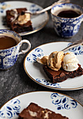 Chocolate brownies topped with vanilla ice cream and salted caramel chocolate ice cream