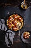 Hot cross bun pudding with custard