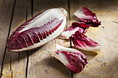 Long red chicory on rustic wooden table