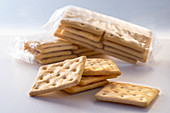 Gluten-free crackers packages ad crackers on a white background