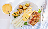 Pork steak with white asparagus and sauce Hollandaise