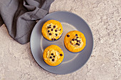 Small pumpkin cheesecakes with chocolate drops
