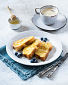 French toast with blackberries and honey served with coffee