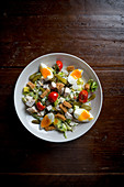 Mixed salad with boiled eggs and bread