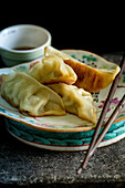 Dumplings with soy sauce (Asia)