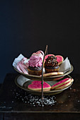 Heart-shaped biscuits and mini cupcakes on a cake stand