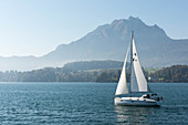 A sailing boar on Lake Lucerne with Mount Pilatus in the background, Lucerne, Switzerland