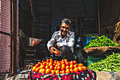 A man selling tomatoes at a market (Jodhpur, India)