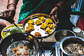 A woman preparing street food, India