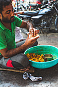 A man preparing street food (India)