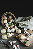 Mushrooms champignon on the wood table