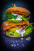 A fish burger with green tomatoes