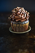 A cupcake with chocolate cream for Valentines day