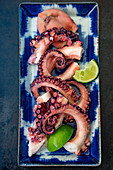 Grilled octopus with limes