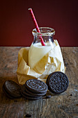 Oreo cookies and a bottle of milk