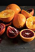 Oranges and blood oranges being juiced