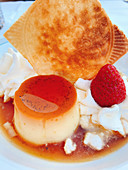 Creme caramel with strawberries