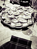 Fresh oysters on a serving platter with champagne