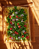 Puff pastry tart with asparagus, spinach, cherry tomatoes and rocket