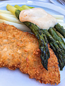 Viennese escalope with green asparagus and sauce Hollandaise