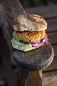 Vegan chickpea and rice burger with cumin, rosemary and grated lemon rind