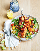 Salmon skewers with mango salad