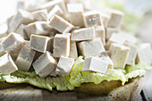Cubes of tofu on cabbage leaf