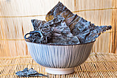 Dried kombu seawead in a ceramic bowl