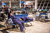 Travellers waiting in airport during Covid-19 outbreak