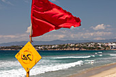Red flag on Pacific Ocean beach, Mexico