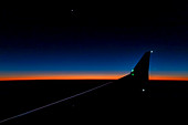 View from passenger jet at sunset