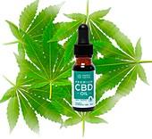CBD oil and cannabis leaves