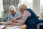 Care home resident and her daughter painting
