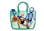 Woven bag with dolls and stuffed animal, X-ray