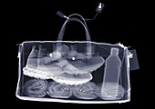 Sports bag with trainers towel and water, X-ray
