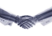 Two executive shaking hands, X-ray